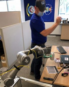 General Manager Mike testing artificial intelligence at the office
